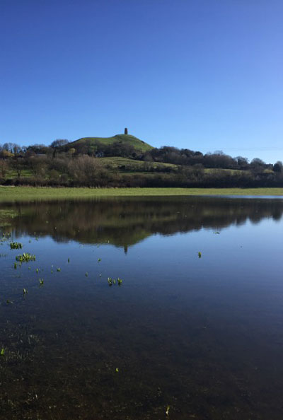 The Tor beyond a flooded River Brue